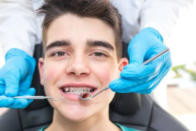 Young man with orthodontics