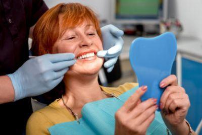 Senior woman with new dentures