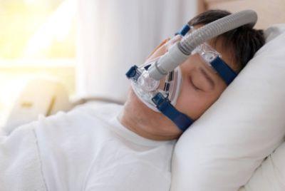 Sleeping man wearing cpap mask