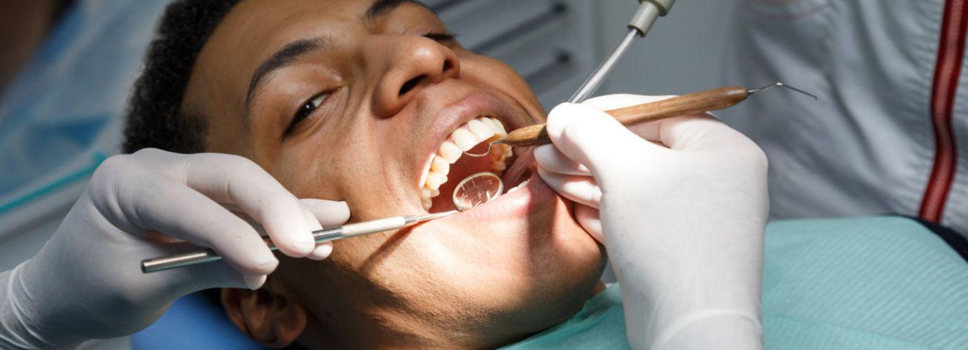 Dentist examining oral cavity