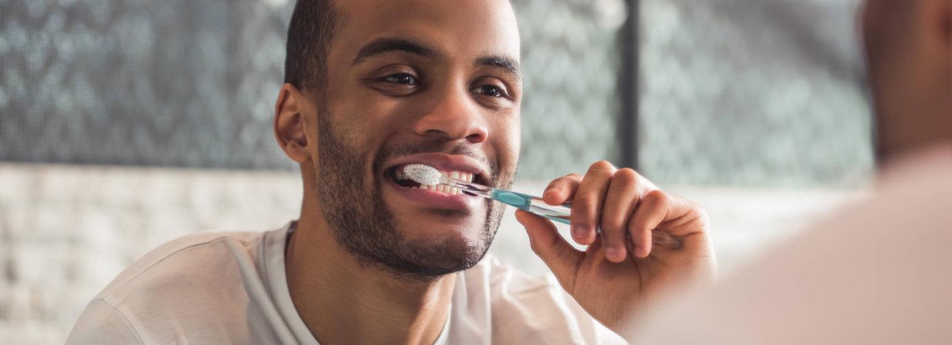 man brushing his teeth